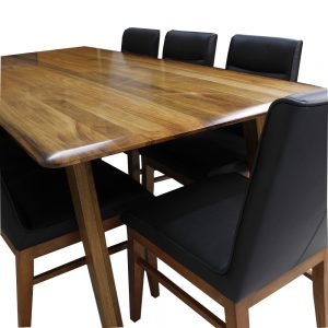 black wood dining table showing the grain of the timber