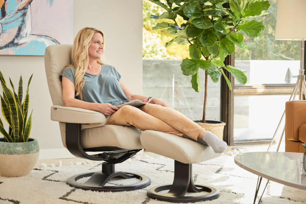 Ergonomic design chair inspired by  Nature and form of the Norwegian Fjords . Contour and technology provide the ultimate in back care and relaxation.