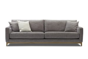tan large sofa with an exposed timber base