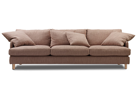 pink 4 seat sofa with cushions and timber feet