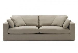 large 4 seat sofa in a cream colour with wide arms