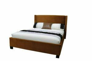 queen bed upholstered in rust cloured quilted velvet