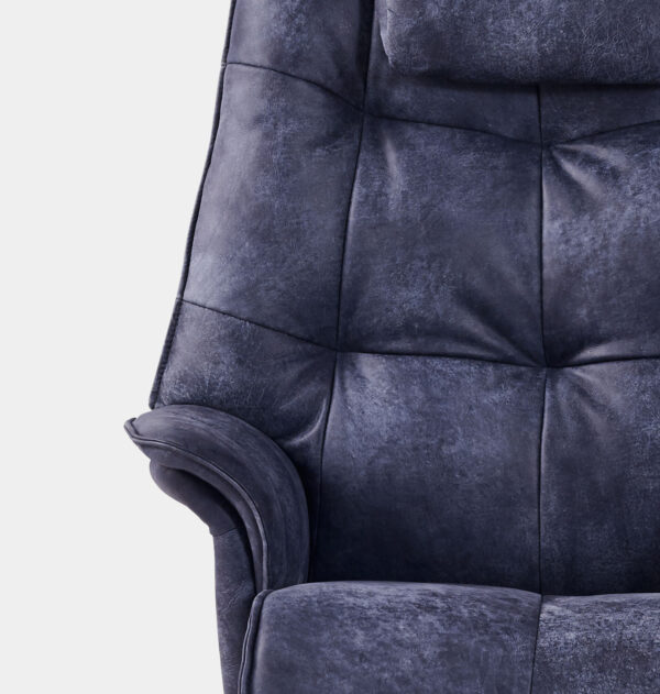 close up of buttoning design on chair
