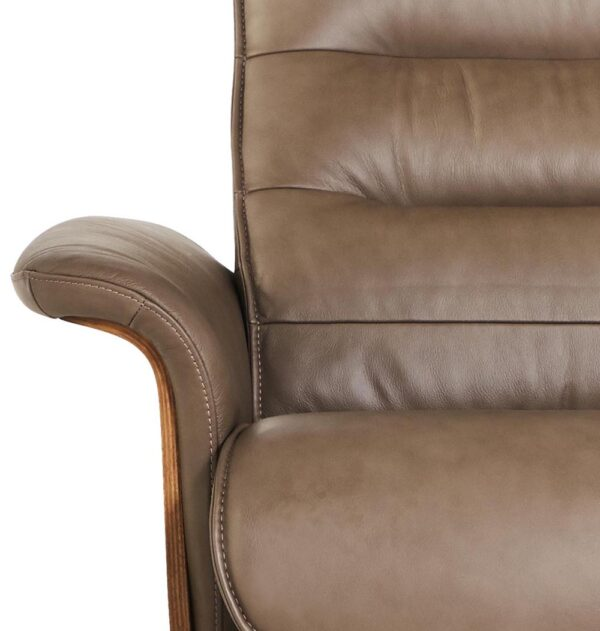 close up face on chair leather tan of curved arm