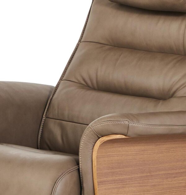 close up of tan leather chair showing stitching detail