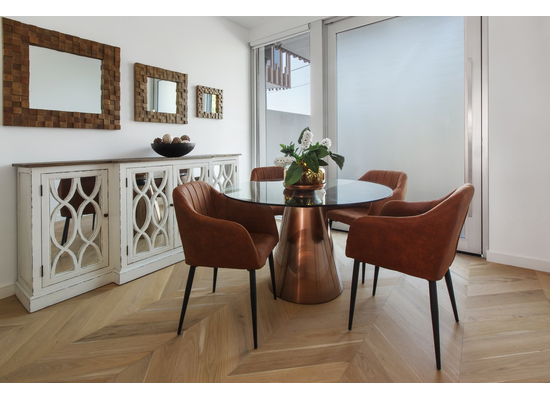 brass and glass dining setting in situ