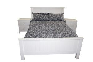 white double bed blue linen